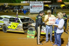 David Stremme of Concord. NC receives his Olykoek Shoppe Donuts after winning the Renehades of Dirt Modified Feature