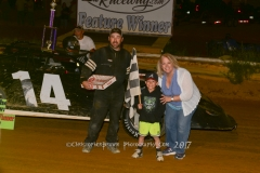 Lance Reynolds of Max Meadows receives his Dozen of OlyKoek Shoppe Donuts after he wins the FASTRAK Feature Race