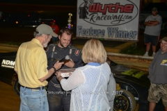 Shawn King of Wytheville receives his Dozen of OlyKoek Shoppe Donuts after he wins the Pro Mini Feature Race